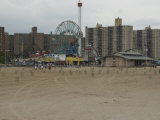 Looking Across the Beach to the Ferris Wheel at Coney Island, Brooklyn, New York Photographic Print by Todd Gipstein
