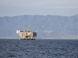 Oil Rig in the Santa Barbara Channel and the Santa Ynez Mountains, California Photographic Print by Rich Reid