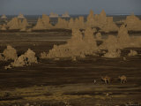 Nomads Pass by Travertine Towers on the Bed of a Shrinking Lake Photographic Print by Chris Johns