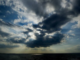 Sun Rays Through Clouds Form a Spot on the Surface of the Water Photographic Print by Todd Gipstein