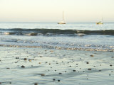 Pebbles in Wet Sand with Small Waves and Sail Boats in the Background, California Photographic Print by James Forte