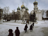 Russian Women, Dressed in Black, Walk Across a Snowy Square Toward Two Orthodox Churches Photographic Print by James L. Stanfield