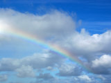 Rainbow in a Cloudy Sky, Hawaii Photographie par Stacy Gold