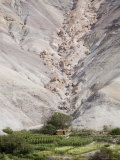 Landslide Boulders Perched Threateningly above Small Building, Chile Photographic Print by David Evans