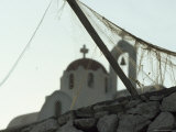 Old Fishing Net Becomes a Tangled Veil for a Small, White, Orthodox Church Photographic Print by James L. Stanfield