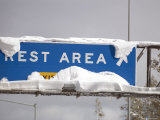 Rest Rea Sign at Donner Summit Covered in Fresh Snow, California Photographic Print by Rich Reid
