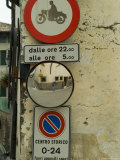 Road Signs and Wide Angle Mirror Along an Italian Road, Asolo, Italy Photographic Print by Todd Gipstein