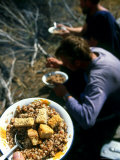 Men on Expedition Enjoy a Hot Meal at Camp Photographic Print by Kate Thompson