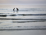 Silhouette of Two People in Sea at Sunset, Romo, Denmark Photographic Print by  Brimberg & Coulson