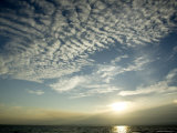 Setting Sun over the Sea with Cloud Filled Sky, Belize Fotografie-Druck von Tim Laman