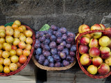 Three Baskets of Colorful Fruit at a Market in Siena, Tuscany, Italy Photographic Print by Todd Gipstein