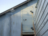 The Entry to a Metal Shed on a Sawmill Farm in Nebraska Photographie par Joel Sartore
