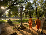 Two Buddhist Monks Walk Along the Siem Reap River at Sunrise, Cambodia Photographic Print by Michael S. Lewis