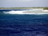 Surf Hits the Outer Reef at Rangiroa Atoll, French Polynesia Photographic Print by Tim Laman