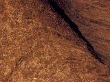 The Rust Oxidisation on the Sandstone Surface of Uluru, Ayres Rock, Australia Photographic Print by Jason Edwards