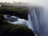 The Iguazu River Cascades over the Precipace into the Misty Abyss Photographic Print by Jason Edwards