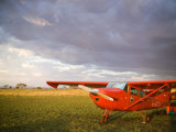 The Cessna Makes a Pit Stop to Refuel on the Serengeti, Tanzania Fotografisk tryk af Michael Fay
