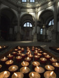 Tray of Lighted Candles in the Chuch of Santa Maria Della Salute, Venice, Italy Photographic Print by Todd Gipstein
