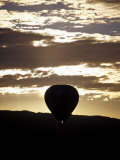 The Silhouette of a Hot Air Balloon and Jet Flame at Dawn, Australia Photographic Print by Jason Edwards