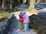 Sisters Show their Love in a Big Greeting Hug Photographic Print by Stacy Gold