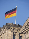 The German Flag Flies High above the New Reichstag in Berlin, Germany Photographic Print by Jason Edwards