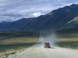 Truck on the Dalton Highway Following the Alyeska Pipeline, Alaska Photographic Print by Rich Reid