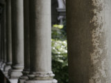 Stone Pillars in an Italian Courtyard, Ravenna, Italy Photographic Print by Gina Martin