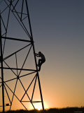 Silhouette of a Man Climbing a High Power Electric Line Tower, California Photographic Print by Dawn Kish