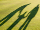 Tall Shadows Loom on the Greens of a Golf Course Fotografie-Druck von Stacy Gold