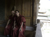 Two Chinese Student Monks Sit Togther on Porch of their Dormitory, Qinghai, China Photographic Print by David Evans