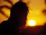 Silhouette of an Aboriginal Dja Dja Wrung Tribal Elder at Sunset, Australia Photographic Print by Jason Edwards