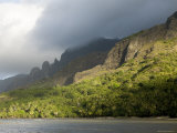 Storm Clouds Rolling in over Sunlit Anaho Bay, French Polynesia Photographic Print by Tim Laman