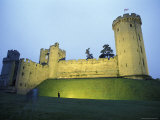 Warwick Castle at Dawn with a Man Walking in Warwickshire, England Photographic Print by Richard Nowitz