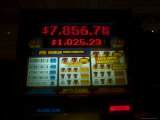 Slot Machine Shows a Growing Jackpot Photographic Print by Heather Perry