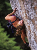 Women Makes a Move on a Rock Climb in Wyoming Photographic Print by Bobby Model