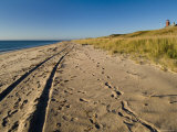 Tire Tracks and Footprints in the Sand Along a Beach by a Lighthouse, Block Island, Rhode Island Photographic Print by Todd Gipstein