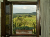Window Looking Out Across Vineyards of the Chianti Region, Tuscany, Italy Photographic Print by Todd Gipstein