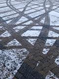 Tire Tracks on Snowy Cobblestone Road, Copenhagen, Denmark Photographic Print by  Brimberg & Coulson