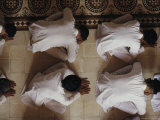 Vietnamese Men Bow Down During Worship at the Cao Dai Great Temple Photographic Print by Steve Raymer