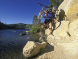 Woman Carries Her Bike to the Flume Trail at Marlette Lake Photographic Print by Rich Reid