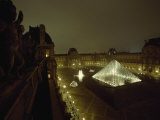 The Pyramid Glows at Night in the Cour Napoleon III at the Louvre, France Photographic Print by James L. Stanfield