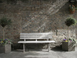 White Bench against a Brick Wall in Ravenna, Italy Photographic Print by Gina Martin