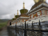 Stupas Behind a Wrought Iron Fence at a Monastery, Qinghai, China Photographic Print by David Evans
