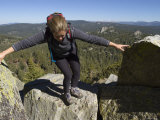 Woman Climbs Atop Jackass Peak in the Sierra Mountains Photographic Print by Rich Reid
