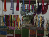 Textiles on Display in the Mutrah Suq, or Market Photographic Print by James L. Stanfield