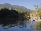 Woman Cools Off While Wading in the Ventura River, California Photographic Print by Rich Reid