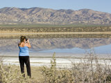 Woman Photographs the Reflection of the Temblor Range in Soda Lake, California Photographic Print by Rich Reid