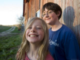Two Siblings Play near an Old Barn in Nebraska Photographic Print by Joel Sartore