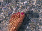 Woman's Foot in the Warm Water of the Gulf of Mexico, Holmes Beach, Florida Photographic Print by Stacy Gold