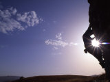 Silhouette of a Woman Climbing, Utah Photographic Print by Kate Thompson